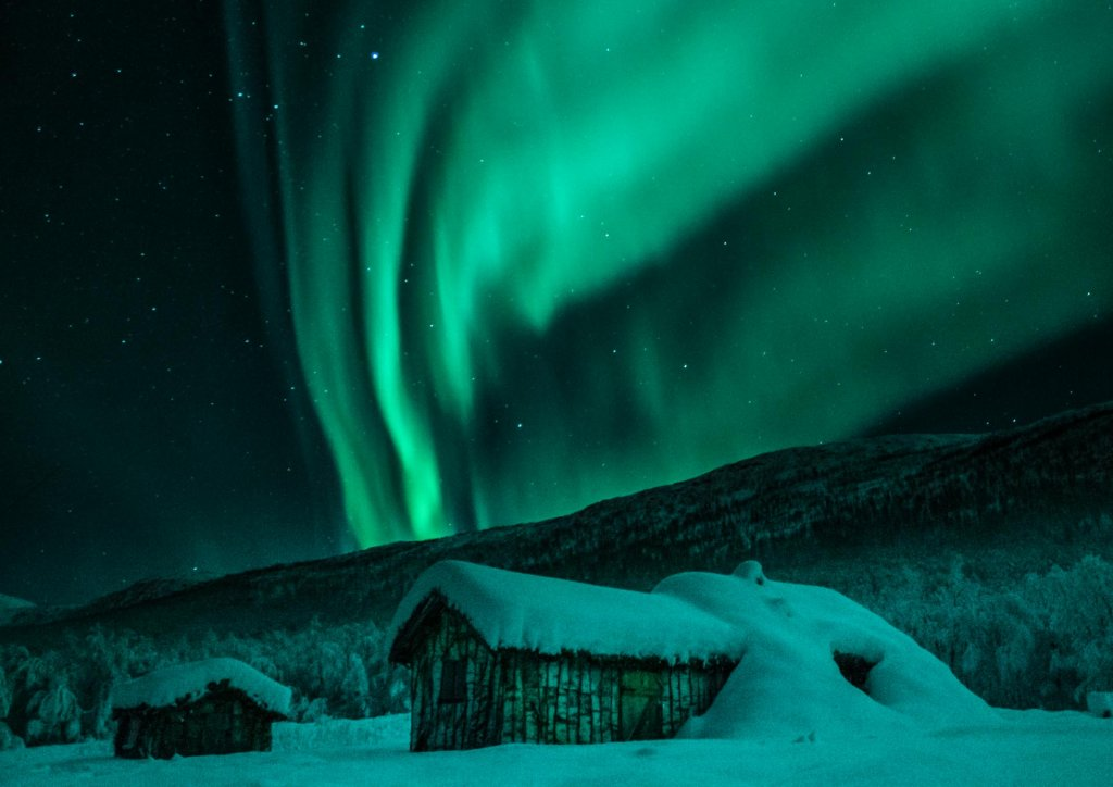Wooden huts northern lights